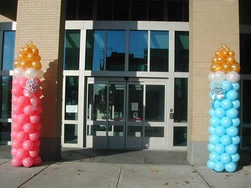 Baby shower ,decora con globos , chupones cigueñas ,sonajeros ,centros de mesa