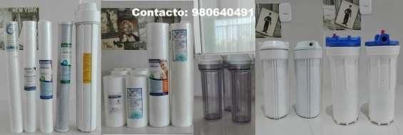 Filtros y porta filtros para envasadoras de agua